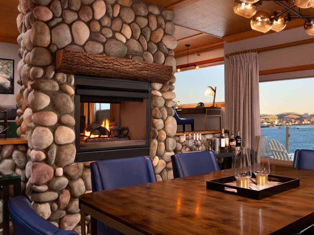 Penthouse eating area with fire place and waterview.